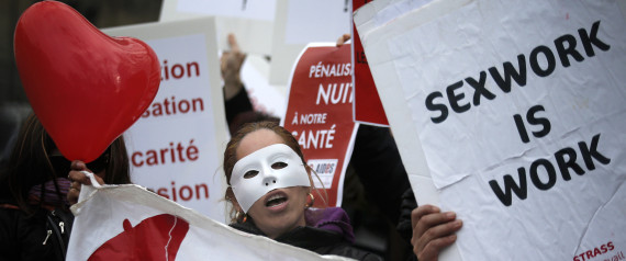 FILE - In this Nov.29, 2013 file photo, a French sex worker demonstrates outside the National Assembly in Paris, France. A French bill aimed at decriminalizing prostitutes and fining their customers is being turned upside down by the Senate, led by the conservative opposition. The proposed bill, aims at introducing a 1,500-euro (about $1,623) fine for customers and decriminalizing the estimated 40,000 prostitutes in France. (AP Photo/Christophe Ena, File)